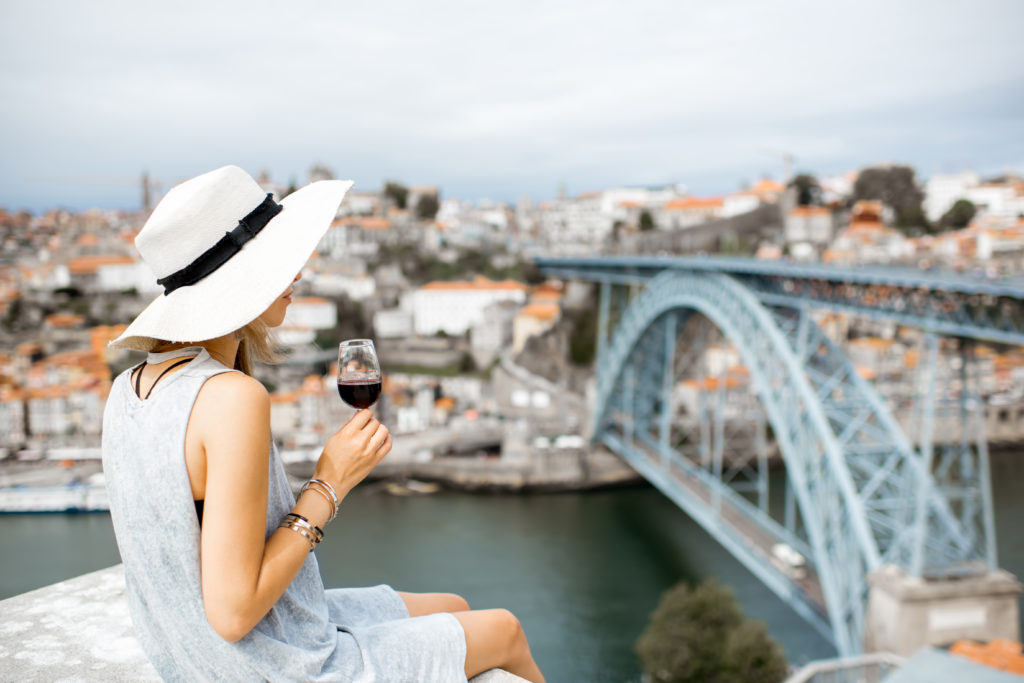 Woman With Glass Of Porto Wine In Portugal